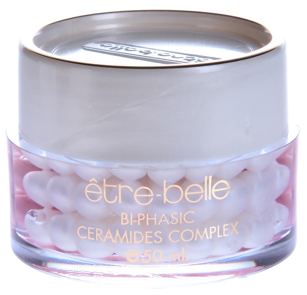 ETRE BELLE Увлажняющий жемчугдвухфазный с церамидами / Bi-Phasic Ceramide Complex 50 млКонцентраты<br>Увлажняющий жемчуг  двухфазный с церамидами (Bi-Phasic Ceramide Complex) от Еtre Вelle Cosmetics не нарушает упругость ткани, а специальный восстановительный комплекс активирует обновление клеток эпидермиса.&amp;nbsp; Активные ингредиенты: Мочевина, церамиды, масло розового муската, цинк, ДНК, соевые протеины.&amp;nbsp; Способ применения: Нанести на очищенную кожу  Увлажняющий жемчуг  двухфазный с церамидами (Bi-Phasic Ceramide Complex) от Еtre Вelle Cosmetics тонким слоем утром и вечером. Использовать одну капсулу.<br><br>Вид средства для лица: Увлажняющий<br>Типы кожи: Сухая и обезвоженная