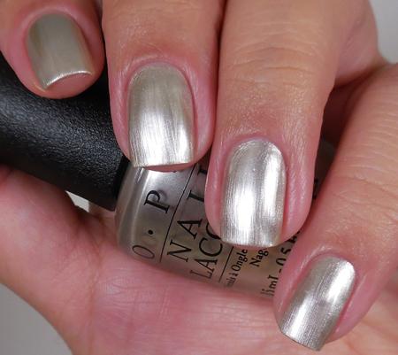 OPI Лак для ногтей This Silvers Mine! / SoftShades 15млЛаки<br>Лак для ногтей Это мое серебро! - я получу все это жемчужное серебро без остатка! (текстура перламутр). Преимущества: - модные оттенки: самые горячие и желанные цвета сезона; - насыщенные цвета: высокопигментированные оттенки обеспечивают оптимальное покрытие;&amp;nbsp; - быстрое нанесение в два слоя: эксклюзивная кисть ProWide для гладкого ровного покрытия; -&amp;nbsp;долговечный цвет: устойчивое к сколам покрытие, стойкий блеск; - легендарные названия оттенков: скоро они будут у всех на устах. Активные ингредиенты: аминокислоты и протеины шелка. Способ применения: нанесите на ногти 1-2 слоя цветного лака после нанесения базового покрытия. Для придания прочности и создания блеска затем рекомендуется использовать верхнее покрытие. Если хотите оставить матовую текстуру лака, не покрывайте его глянцевым верхним покрытием!<br><br>Цвет: Серые<br>Объем: 15 мл<br>Виды лака: Перламутровые