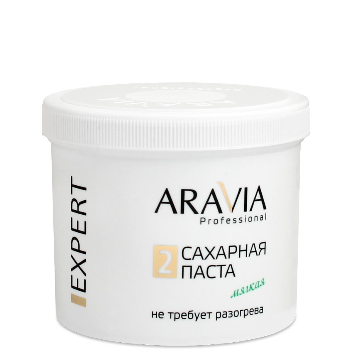 ARAVIA Паста сахарная для депиляции Мягкая / EXPERT 750грСахарные пасты<br>Пластичная, мягкая и невероятно удобная в работе новая паста EXPERT создана специально для мастеров с большим опытом работы, владеющих скоростными методиками. Паста легко наносится, обеспечивает идеальное сцепление с волосами, не растекается и не меняет свою консистенцию во время работы, не требует разогрева и длительной подготовки к работе, позволяя решать задачи любой сложности. Результат: 100% чистое удаление нежелательных волос с кожи, без раздражения. Назначение: для всех типов волос и кожи. Зоны депиляции: бикини, бёдра, голени, руки, спина. Рабочая температура продукта: комнатная. Техника депиляции: мануальная, шпательная, смешанная. Расход: от 15 процедур. Активные ингредиенты: глюкоза, фруктоза, вода. Способ применения: - на всех этапах для получения выраженного эффекта рекомендуется использовать средства ухода Aravia Professional обезжирить кожу с помощью лосьона или геля. - для улучшения сцепления с волосом нанести тальк. - взять небольшое количество пасты. - провести процедуру депиляции. - снять остатки пасты косметической минерализованной водой. Завершить процедуру средствами для ухода за кожей - нанести средство для замедления роста волос и питательные сливки. Примечание: - не требует разогрева. - предназначена для мастеров с большим опытом работы. - гипоаллергенный продукт.<br>