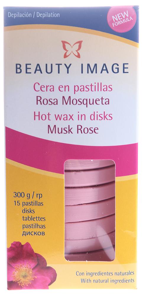BEAUTY IMAGE Воск горячий в дисках розовый Мускатная Роза (15 дисков) 300грВоски<br>Горячий воск в дисках с маслом мускатной розы. Для жестких коротких волос. Горячие воски Beauty Image обладают высокой эластичностью, содержат натуральные добавки и высокий процент натуральной смолы соснового дерева. Не раздражают кожу и хорошо удаляют волосы разной длины и толщины, не оставляют сломанных волосков. Рабочая температура воска (55-60 градусов) при нанесении на кожу позволяет ей распариться, поры открываются, и волосы вместе с воском удаляются безболезненно и легко. Горячие воски особенно удобны при депиляции на чувствительных участках тела. а особенно при выполнении глубокого бикини, бикини-дизайна и депиляции подмышек. Разогревается воск до консистенции меда в специальном нагревателе, затем деревянным шпателем наносится на зону, предназначенную для депиляции. Немного остывая, он образует пленку, которая удаляется вместе с ненужными волосами. Активные ингредиенты: Смола натуральная, воск микрокристаллический, глицерил гидрогенизированный R. ВАЖНО! Нанесение и удаление горячего воска не зависит от направления роста волос. Удаляется горячий воск только рукой, без помощи бумаги. Перед использованием сделайте ТЕСТ НА ЧУВСТВИТЕЛЬНОСТЬ КОЖИ, нанесите воск на небольшой участок кожи в том месте, где будут удалятся волосы, следуя инструкции по применению. Если в течение 24 часов не появилось раздражение, воск можно использовать. &amp;bull; Кожа должна быть чистой, сухой, без крема или масла. &amp;bull; Удаляемые волосы должны быть оптимальной длины - не менее 5 - 7 мм &amp;bull; Разогревайте воск только в специальных нагревателях. &amp;bull; Для удобства работы используйте специализированные баночки алюминиевые и держатели для банок с воском. &amp;bull; Эпиляция не проводится, если кожа травмирована или на ней имеется раздражение или последствия солнечного ожога. &amp;bull; Если на участке тела, где проводится эпиляция, имеются накожные доброкачественные новообразования (папилло