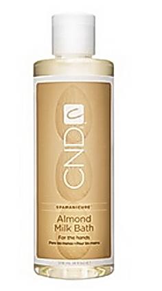 CND Молочко для мацерации / Milk Bath ALMOND SPA MANICURE 975млМолочко<br>Увлажняющая масляная жидкость. При соединении с теплой водой в равной пропорции жидкость превращается в увлажняющую молочную ванну для ногтей и кожи. Хитом этой смеси является масло сладкого миндаля, масло жожоба и витамин Е, которые смягчают и глубоко кондиционируют кожу и ногти перед процедурой маникюра. Тонкий аромат миндаля, витающий в воздухе, создает атмосферу изысканного ритуала.<br><br>Объем: 975