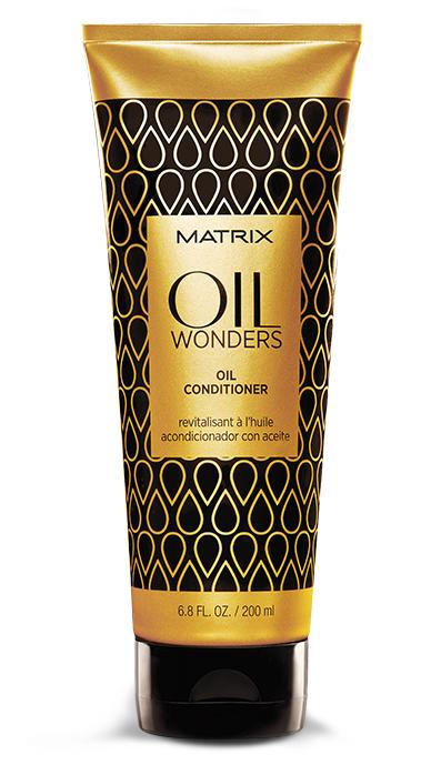 MATRIX Кондиционер с марокканским аргановым маслом/ ОИЛ ВАНДЕРС 200 млКондиционеры<br>Matrix Oil Wonders невесомый кондиционер, обогащенный Марокканским аргановым маслом, возвращает волосам дисциплину, делает их мягкими на ощупь. Придает дополнительное сияние, разглаживая кутикулу волоса, тем самым упрощая процесс укладки. Невесомое кондиционирование и питание волоса. Подходит для всех типов волос. Активные ингредиенты: марокканское аргановое масло. Способ применения: после использования шампуня с микро-каплями масла OIL WONDERS массирующими движениями нанести кондиционер на влажные волосы. Оставить на 1-3 минуты. Тщательно смыть. Для максимального персонализированного результата добавить в кондиционер 1-2 капли масла для окрашенных волос Египетский Гибискус или укрепляющего масла Индийское Амла или разглаживающего масла Амазонская Мурумуру, оставить на 1-3 минуты. Тщательно смыть.<br><br>Вид средства для волос: Укрепляющая