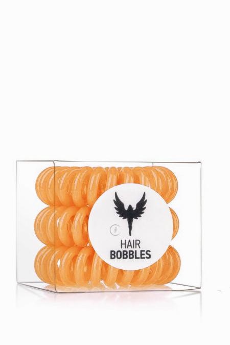 HAIR BOBBLES HH Simonsen Резинка для волос Оранжевая / Hair Bobbles HH SimonsenРезинки<br>Цвет - оранжевый. Заботливая резинка для волос в форме спирали. Эта резинка устроена так, что не повреждает волосы, ее легко можно снять. Hair Bobble не оставляет следов на ваших волосах после применения. Она водоотталкивающая, с ней можно ходить в бассейн, заниматься спортом, ее можно применять как стильный браслет. Hair Bobble для волос изготовлена из экологически чистых материалов. Активные ингредиенты. Состав: силикон. Способ применения: 2 в 1, резинка для волос и стильный браслет.<br>