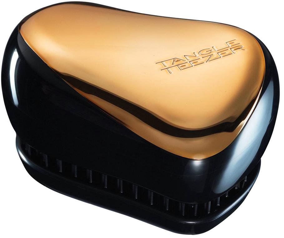 TANGLE TEEZER Расческа / Tangle Teezer Compact Styler BronzeРасчески<br>Профессиональная распутывающая расческа Tangle Teezer идеально подходит для всех типов волос. Оригинальная форма зубчиков обеспечивает двойное действие и позволяет расчесать сухие и влажные волосы легко и быстро, без рывков и усилий. Благодаря эргономичной форме расчёска удобно ложится в ладонь, позволяя более творчески подойти к процессу укладки. Активные ингредиенты. Состав: гипоаллергенный пластик. Способ применения: оригинальная форма зубчиков обеспечивает двойное действие и позволяет быстро и безболезненно расчесать влажные и сухие волосы. Благодаря эргономичному дизайну, расческу удобно держать в руках, не опасаясь выскальзывания. Расческа дополнена удобным футляром.<br><br>Класс косметики: Профессиональная<br>Типы волос: Для всех типов