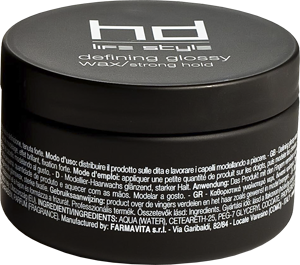 FARMAVITA Воск глянцевый сильной фиксации DEFINING GLOSSY WAX / HD LIFE STYLE 100 млВоски<br>Глянцевый воск Defining glossy wax/strong hold от итальянской марки косметики для волос FarmaVita обладает сильной степенью фиксации. Средство с уникальным глянцевым эффектом используется для придания стойкости укладке, создания креативного образа и придания волосам потрясающего блеска. Кокосовое масло заботится о волосах, обеспечивает их гладкость и силу. Невероятный аромат воска дарит ощущение морского бриза. Способ применения: в руках разотрите немного воска Defining glossy wax/strong hold и нанесите на волосы, создавая желаемую прическу.<br><br>Объем: 100 мл