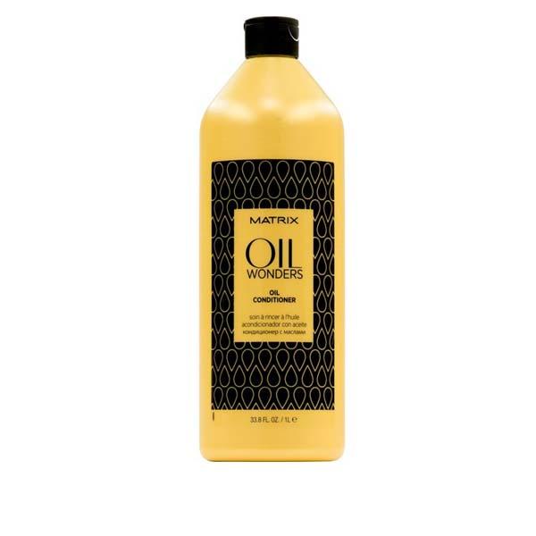 MATRIX Кондиционер с марокканским аргановым маслом/ ОИЛ ВАНДЕРС 1000млКондиционеры<br>Невесомый кондиционер,обогащенный Марокканским аргановым маслом, возвращает волосам дисциплину, делает их мягкими на ощупь. Придает дополнительное сияние, разглаживая кутикулу волоса, тем самым упрощая процесс укладки. Преимущества: - обогащен Марокканским аргановым маслом. - невесомое кондиционирование и питание волоса. - подходит для всех типов волос. Способ применения: - после использования шампуня с микро-каплями масла OIL WONDERS массирующими движениями нанести кондиционер на влажные волосы. - оставить на 1-3 минуты. - тщательно смыть. Для максимального персонализированного результата добавить в кондиционер 1-2 капли масла для окрашенных волос Египетский Гибискус или укрепляющего масла Индийское Амла или разглаживающего масла Амазонская Мурумуру, оставить на 1-3 минуты. Тщательно смыть.<br><br>Объем: 1000 мл<br>Вид средства для волос: Укрепляющая