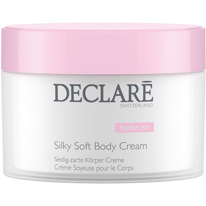 DECLARE Крем для тела Шелковое прикосновение / Silky Soft Body Cream 200млКремы<br>Роскошный крем для тела питает и великолепно увлажняет самую требовательную кожу, обеспечивает оптимальный комфорт и гладкость, устраняет раздражение и шелушение. Тонкий сбалансированный аромат клюквы, черной смородины, ландыша и мускуса дарит коже ощущение свежести. Способ применения: небольшое количество средства нанести мягкими круговыми движениями на кожу после принятия ванны или душа. Активные ингредиенты:   Масло кокоса   Масло семян клюквы   Масло семян подсолнечника   Экстракт розмарина   Витамин Е<br><br>Объем: 200 мл
