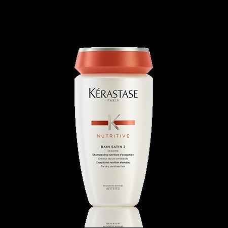 KERASTASE Шампунь-ванна САТИН р2 / НУТРИТИВ 250млШампуни<br>В каждом шампуне Satin содержатся глюкоза, белки и липиды, которые восстанавливают баланс питания волос от корней до кончиков и защищают волосы от пересушивания. Волосы становятся легкими и одновременно более крепкими. Они мягкие на ощупь и наполнены сиянием. Активные ингредиенты: Gluco-Active 2 Dosage. Глюкоза+Белки+Липиды 2100 PPM Наша первая питательная процедура с использованием активной глюкозы для комплексного питания.   Глюкоза: Заряд энергии для питания волос.   Белки: Питают волосы и оставляют ощущение мягкости. Липиды: Защищают волосы от пересушивания и укрепляют природные защитные механизмы. Способ применения:   Тщательно намочите волосы.   Нанесите шампунь-ванну Satin 2.   Пальцами распределите шампунь по коже головы и волосам, легкими массирующими движениями превратите средство в пену и тщательно смойте.   Нежными массирующими движениями нанесите шампунь вновь и оставьте на несколько минут.   Добавьте немного воды и деликатно взбейте средство в пену, тщательно смойте.<br><br>Типы волос: Сухие